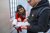 General election 2015: Tulip Siddiq, Labour candidate for Hampstead & Kilburn, the second most marginal seat in the UK, checks a list of voters during a canvassing session in a social housing block in Swiss Cottage.