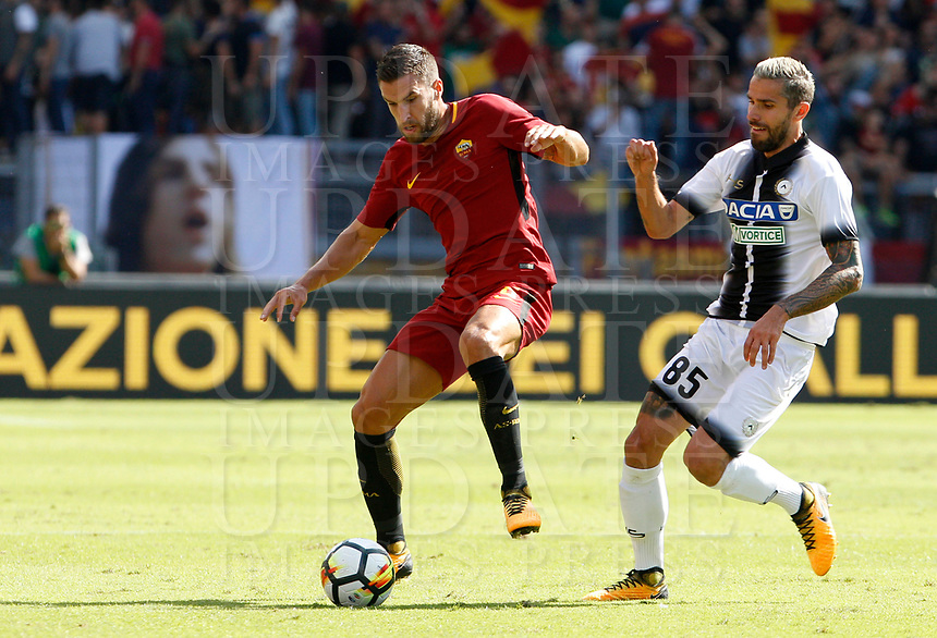 Calcio, Serie A: Roma vs Udinese. Roma, stadio Olimpico, 23 settembre 2017.<br /> Roma's Kevin Strootman, left, is chased by Udinese's Valon Behrami during the Italian Serie A football match between Roma and Udinese at Rome's Olympic stadium, 23 September 2017. Roma won 3-1.<br /> UPDATE IMAGES PRESS/Riccardo De Luca