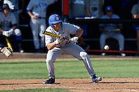 Joey Epperson #23 of the UC Santa Barbara Gauchos bunt's against the Cal State Northridge Matadors at Matador Field on May 10, 2013 in Northridge, California. UC Santa Barbara defeated Cal State Northridge, 6-1. (Larry Goren/Four Seam Images)