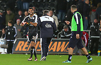 Riyad Mahrez of Leicester City celebrates with the match ball at full time after scoring a hattrick during the Barclays Premier League match between Swansea City and Leicester City played at The Liberty Stadium on 5th December 2015