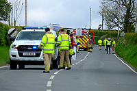 Pictured: Emergency services on the A478 road near Llandissilio in Wales, UK. Monday 17 May 2021<br />Re: Emergency services are the scene of a serious collision on the A478 near Llandissilio in Pembrokeshire, Wales, UK.<br />The collision involved a motorcar and a bus carrying school children and was reported to police at 8.35am.<br />A number of children received minor injuries with two taken to hospital by ambulance with what are described as minor injuries.<br />The road is currently closed and officers remain at the scene.