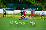 Dynamos James Sugrue been well tagged by Simon Kerderdki of Strand Road in the Senior soccer league on Sunday