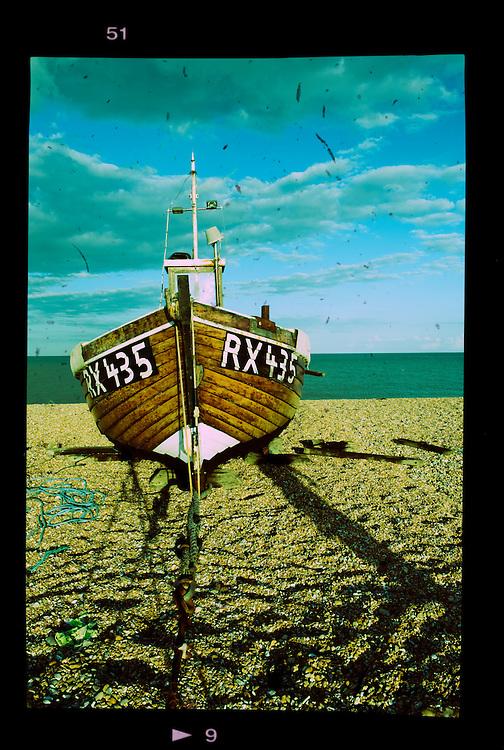 Small boat on a shingle beach