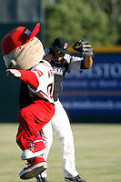 Wilin Rosario -  Modesto Nuts bumps with the Modesto mascot, Wally, before a game against the Visalia Rawhide at John Thurman Field, Modesto, CA - 05/19/2009.Photo by:  Bill Mitchell/Four Seam Images