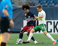 FOXBOROUGH, MA - AUGUST 26: Aaron Walker #8 of Greenville Triumph SC pressures Isaac Angking #5 of New England Revolution II during a game between Greenville Triumph SC and New England Revolution II at Gillette Stadium on August 26, 2020 in Foxborough, Massachusetts.