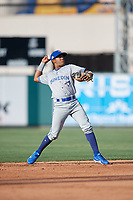 Dunedin Blue Jays shortstop Jesus Navarro (10) throws to first base during a Florida State League game against the Lakeland Flying Tigers on May 18, 2019 at Publix Field at Joker Marchant Stadium in Lakeland, Florida.  Dunedin defeated Lakeland 3-2 in eleven innings.  (Mike Janes/Four Seam Images)