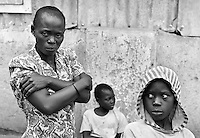 Two young boys with their AIDS-sick mother in Kampala, Uganda, on April 21, 2001. More than 13 million African children have been orphaned by the the AIDS pandemic. Worldwide, more than 20 million people have died since the first cases of AIDS were identified in 1981.