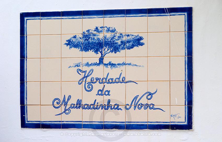 Enamelled tiles as a winery sign. Herdade da Malhadinha Nova, Alentejo, Portugal