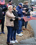 WATERBURY CT. 31 December 2018-123118SV05-From left, Lenora Agostine and Janice Mullaly both of Waterbury join flag wavers outside Calvary Cemetery in Waterbury Monday.<br /> Steven Valenti Republican-American