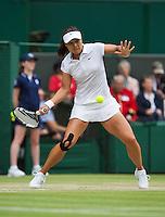 02-07-13, England, London,  AELTC, Wimbledon, Tennis, Wimbledon 2013, Day eight, Na Li (CHN)<br /> <br /> <br /> <br /> Photo: Henk Koster