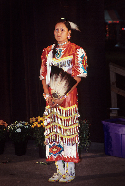 Young Cherokee woman dressed in a jingle dress on the Qualla Indian Reservation, NC