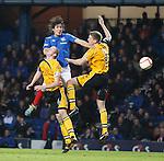 Fran Sandaza wins the high ball in the box past Annan defenders Steven Swinglehurst and Peter Watson