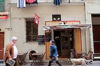 Pedestrians pass by the restaurant 'Chat Noir, Chat Blanc', Nice, France, 10 April 2012