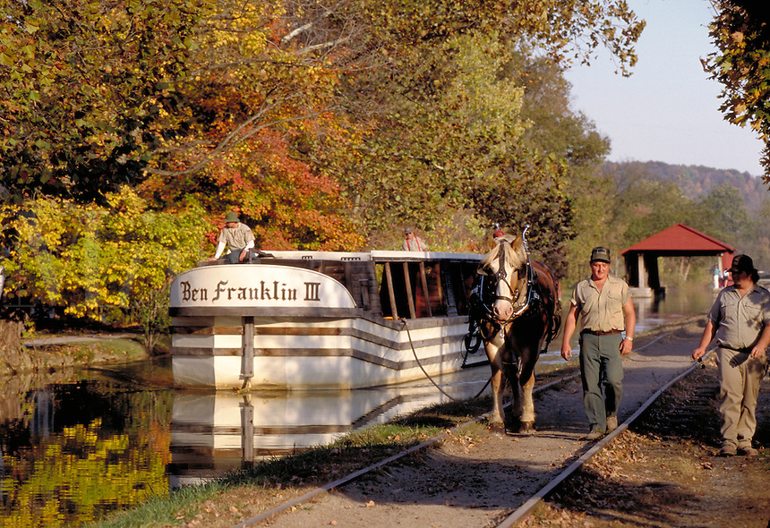 "A horse-drawn canal boat, """"Benjamin Franklin III"""", offers rides on the old canal at Whitewater Canal State Historic Site. Metamora Indiana."