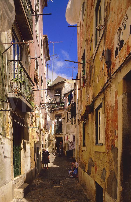Lisbon, Portugal.  Narrow cobbled street in the Alfama.