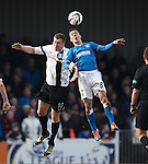 Ian Black wins the ball in the air from Kevin Kyle