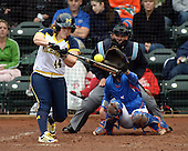 Michigan Wolverines infielder Caitlin Blanchard (44) at bat in front of catcher Aubree Munro (1) and umpire Tyrone Miller during the teams season opener against the Florida Gators on February 8, 2014 at the USF Softball Stadium in Tampa, Florida.  Florida defeated Michigan 9-4 in extra innings.  (Mike Janes/Four Seam Images via AP Images)
