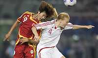 China forward (9) Han Duan heads the ball over Denmark defender (4) Gitte Andersen during their first round game at the 2007 FIFA Women's World Cup at Wuhan Sports Center Stadium in Wuhan, China.  China defeated Denmark, 3-2.