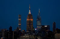 JERSEY CITY - NEW JERSEY - MARCH 26: The Empire State Building is lit in gold and black to mark the Stop Asian Hate campaign, on March 26, 2021 as seen from Jersey City, New Jersey. New York's tourism and its industries have been struck hard by the Covid-19 pandemic, with no more than 33% of people visited NYC in 2020, compared with 66 million in 2019, now the big apple hopes to welcome more than 36 million during year.(Photo by Emaz/VIEWpress)