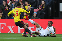 Jordan Ayew of Swansea City (R) is fouled by Andre Carrillo of Watford (L) during the Premier League match between Watford and Swansea City at the Vicarage Road, Watford, England, UK. Saturday 30 December 2017