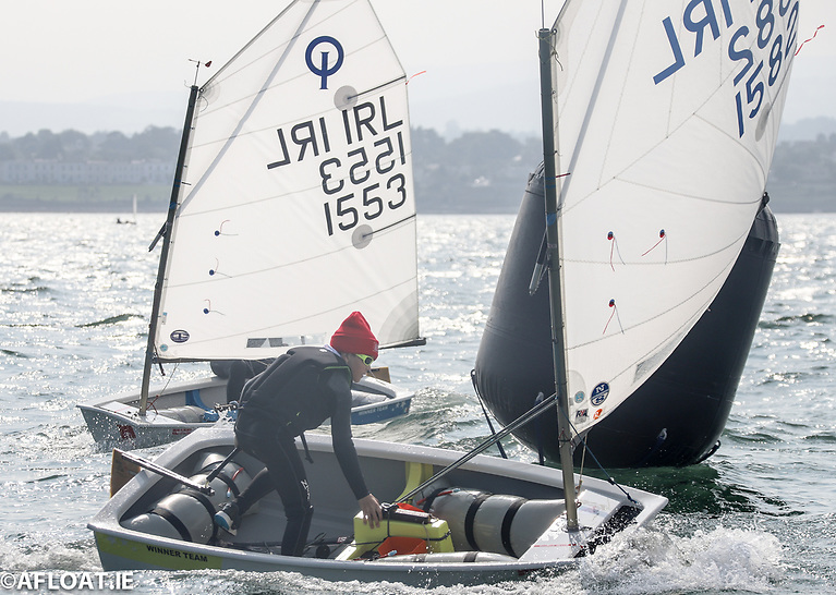 Royal Cork Yacht Club's Rían O'Neill (1582)  leads Niamh Connell of Skerries Sailing Club (1553) round a weather mark in the Junior fleet of the Royal St. George Yacht ClubSummer Optimist Championships on Dublin Bay