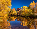 Autumn Scene at Crescent Moon Ranch, Sedona.  Here's another one of those postcard-worthy views which abound around Sedona in the fall, this time looking at Cathedral Rock across an Oak Creek swimming hole.  Many riparian areas around Arizona have been destroyed by development or by diversion of the flowing water, so we do everything we can to preserve and treasure those that remain.<br /> <br /> Image ©2019 James D. Peterson