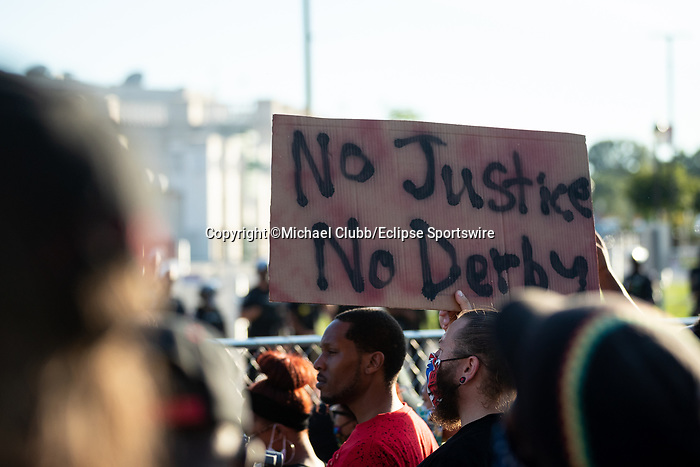 """September 5, 2020: A Black Lives Matter protester holds up a sign outside of Churchill Downs  the 146th Kentucky Derby. With the Kentucky Derby being the biggest sports event for the State of Kentucky, protestors have chosen the  event as a focal point for their calls for justice in the death of Breonna Taylor. Multiple groups from around the country have converged on Louisville to protest during the """"Run for the Roses"""" at Churchill Downs in Louisville. Michael Clubb/Eclipse Sportswire/CSM"""