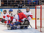 Sochi, RUSSIA - Mar 11 2014 -  Billy Bridges looks on as the puck enters the net as Canada takes on Czech Republic in Sledge Hockey at the 2014 Paralympic Winter Games in Sochi, Russia.  (Photo: Matthew Murnaghan/Canadian Paralympic Committee)