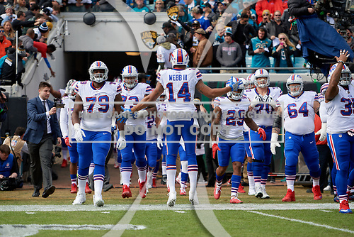 Buffalo Bills, lead by Joe Webb (14), take the field during introductions before an NFL Wild-Card football game against the Jacksonville Jaguars, Sunday, January 7, 2018, in Jacksonville, Fla.  (Mike Janes Photography)