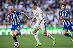 Cristiano Ronaldo (r) of Real Madrid battles for the ball with Gaizka Toquero Pinedo of Deportivo Alaves during their La Liga match between Real Madrid and Deportivo Alaves at the Santiago Bernabeu Stadium on 02 April 2017 in Madrid, Spain. Photo by Diego Gonzalez Souto / Power Sport Images