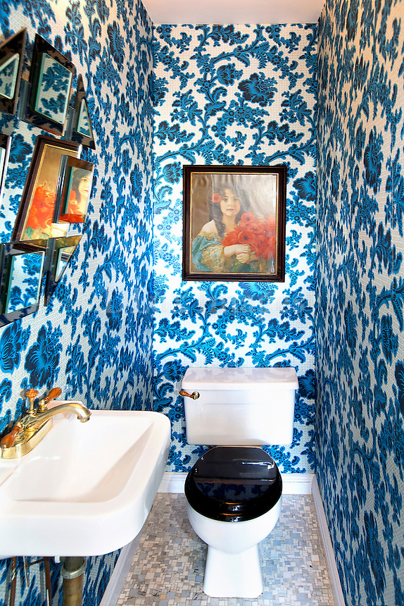 blue floral wallpaper in the bathroom
