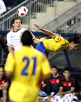 Heath Pearce #14 of the USA MNT beats Falcao Garcia #9 of Colombia to a header during an international friendly match at PPL Park, on October 12 2010 in Chester, PA. The game ended in a 0-0 tie.