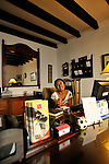 "The receptionist in a cozy hotel in  Antigua, Guatemala  during colorful and festive ""Semana Santa"" (Saint week). ..Antigua, a colonial town, is a UNESCO World Heritage site."