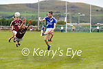 Sure footed Anthony Cournane for St Marys shoots as Piarsaigh na Dromoda's Caoimhín Ó Siocháin  tries to make the block.