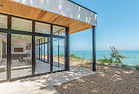 BNPS.co.uk (01202 558833)<br /> Pic: Strutt&Parker/BNPS<br /> <br /> A former WW2 battery, with unrivalled views across the channel to France, has come on the market - but you'll need deep pockets to shell out on its stunning location.<br /> <br /> The cliff top gun emplacement was rapidly constructed in 1940, as Britsh troops were fleeing Dunkirk, and has now been transformed into a £6million 'James Bond style' property.<br /> <br /> The Gunnery, near Kingsdown in Kent offers 'incredible' views of the Channel, with the iconic White Cliffs of Dover visible to the west, and France to the south, while also coming with six acres of sandy beach.<br /> <br /> The unique 82ft long property is accessed by an underground tunnel that leads through the cliff to a glass lift which travels up to it. Another secret tunnel inside the four bedroom home, which is just a few feet from the cliff edge, provides passage to a home cinema.<br /> <br /> The 50ft long living room has floor to ceiling windows and the original gun loops can still be seen.