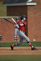 Michael Anastasia (9) of the NJIT Highlanders follows through on his swing against the High Point Panthers at Williard Stadium on February 18, 2017 in High Point, North Carolina. The Panthers defeated the Highlanders 11-0 in game one of a double-header. (Brian Westerholt/Four Seam Images)