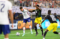 DALLAS, TX - JULY 25: Matthew Hoppe #13 of the United States keeps Alvas Powell #5 of Jamaica away from the ball during a game between Jamaica and USMNT at AT&T Stadium on July 25, 2021 in Dallas, Texas.