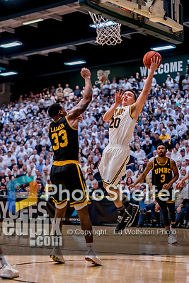 16 March 2019: University of Vermont Catamount Guard Ernie Duncan, a Redshirt Senior from Evansville, IN, lays one up in the second half against the UMBC Retrievers in the America East Championship Game at Patrick Gymnasium in Burlington, Vermont. The Catamounts defeated the Retrievers 66-49, avenging their loss against the same team in last years' Championship Game. Mandatory Credit: Ed Wolfstein Photo *** RAW (NEF) Image File Available ***