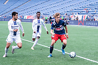 FOXBOROUGH, MA - JULY 4: Noel Buck #61 of the New England Revolution II near the Greenville Triumph SC goal with defenders Cesar Murillo #4 of Greenville Triumph SC and Abdi Mohamed #26 of Greenville Triumph SC applying pressure during a game between Greenville Triumph SC and New England Revolution II at Gillette Stadium on July 4, 2021 in Foxborough, Massachusetts.