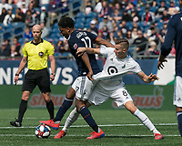 Foxborough, Massachusetts - March 30, 2019: First half action. In a Major League Soccer (MLS) match, New England Revolution (blue/white) vs Minnesota United FC (white), at Gillette Stadium.