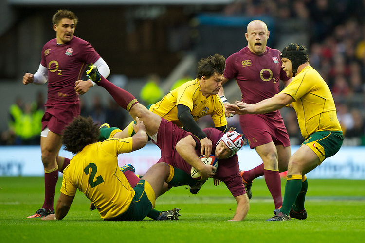 Thomas Waldrom of England is tackled by Adam Ashley-Cooper of Australia during the Cook Cup between England and Australia, part of the QBE International series, at Twickenham on Saturday 17th November 2012 (Photo by Rob Munro)