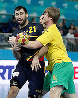Spain's Joan Canellas (l) and Australia's Tim Anderson during 23rd Men's Handball World Championship preliminary round match.January 15,2013. (ALTERPHOTOS/Acero) /NortePhoto