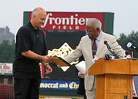 August 29, 2003:  Cal Ripken Jr. receives an award as he's inducted into the Rochester Red Wings Hall of Fame before an International League game at Frontier Field in Rochester, NY.  Photo by:  Mike Janes/Four Seam Images