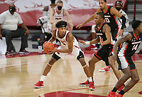 Arkansas guard Moses Moody (5) looks to pass, Saturday, January 9, 2021 during the second half of a basketball game at Bud Walton Arena in Fayetteville. Check out nwaonline.com/210110Daily/ for today's photo gallery. <br /> (NWA Democrat-Gazette/Charlie Kaijo)