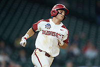 Robert Moore (1) of the Arkansas Razorbacks hustles down the first base line against the Baylor Bears in game nine of the 2020 Shriners Hospitals for Children College Classic at Minute Maid Park on March 1, 2020 in Houston, Texas. The Bears defeated the Razorbacks 3-2. (Brian Westerholt/Four Seam Images)