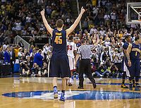 March 21st, 2013: California's David Kravish celebrates during the final seconds of the West Coast Conference men's basketball game against UNLV at HP Pavilion, San Jose, California. California defeated UNLV 64 - 61