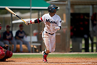 GCL Marlins Victor Mesa Jr. (9) hits a double off the fence during a Gulf Coast League game against the GCL Cardinals on August 12, 2019 at the Roger Dean Chevrolet Stadium Complex in Jupiter, Florida.  GCL Marlins defeated the GCL Cardinals 9-2.  (Mike Janes/Four Seam Images)
