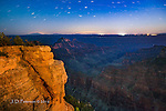 North Rim by Moonlight, Grand Canyon ©2016 James D Peterson.  This image was made around midnight just before a half moon set in the west.  Thus, the moonlight bathed the canyon in warm hues, like the setting sun would.  The volcanic peaks of Northern Arizona (around Flagstaff and Williams) can be seen on the horizon, and the three clusters of bright lights above the rim across the canyon are (from the right) Grand Canyon Village, the town of Tusayan, and the town of Williams.  The four minute exposure caused the stars in the southern sky to stretch out into star trails, and the tracks of an airplane can be seen as a dotted line in the sky.