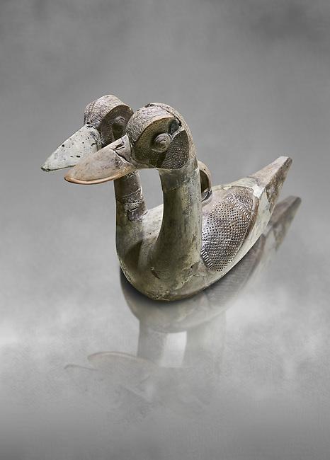 Hittite terra cotta ritual vessel in the shape of a duck with two heads - 16th century BC - Hattusa ( Bogazkoy ) - Museum of Anatolian Civilisations, Ankara, Turkey . Against grey art background