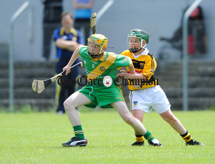 Tom Lynch of O Callaghan's Mills in action against Liam O Donnell Of Bodyke during their U-14C final at Cusack Park. Photograph by John Kelly.